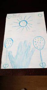 Niebieski rysunek - dłoń, słoneczko, balony